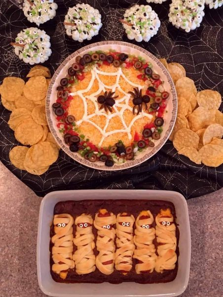 Halloween party food including mummies in a graveyard