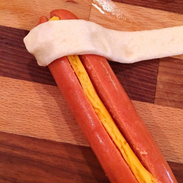 crescent dough rolled around the hot dog