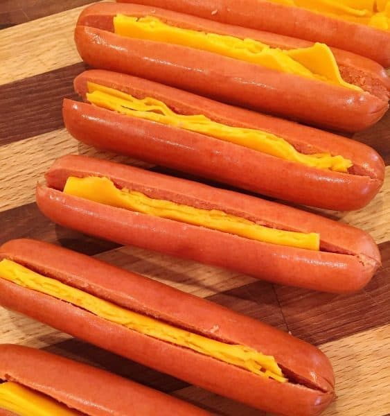 Slit Hot Dogs stuffed with Cheddar Cheese