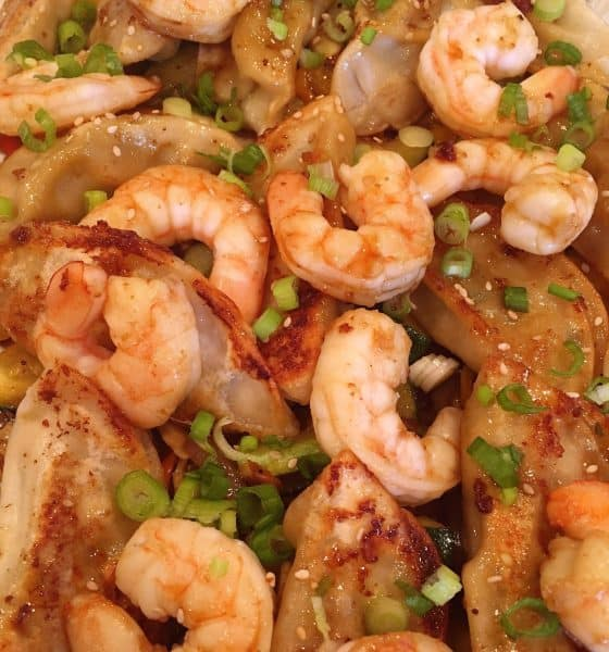 Potstickers with Shrimp layered on Vegetable Stir Fry