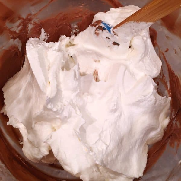 Addition of cool whip to cream cheese mixture