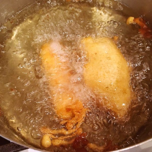 Fish frying in oil