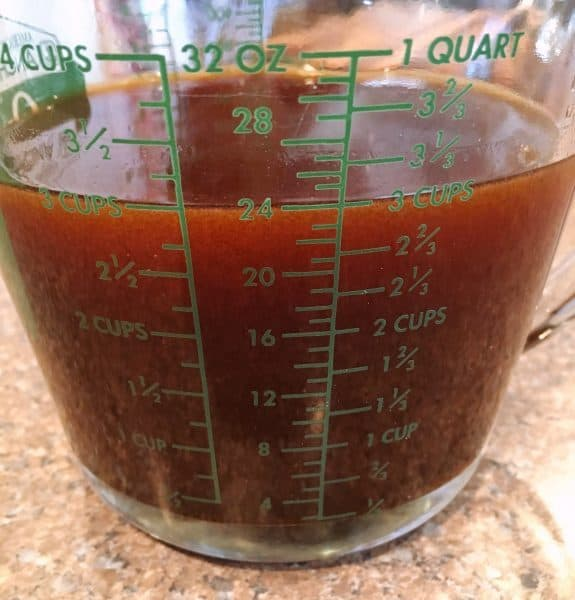Sauce in measuring cup