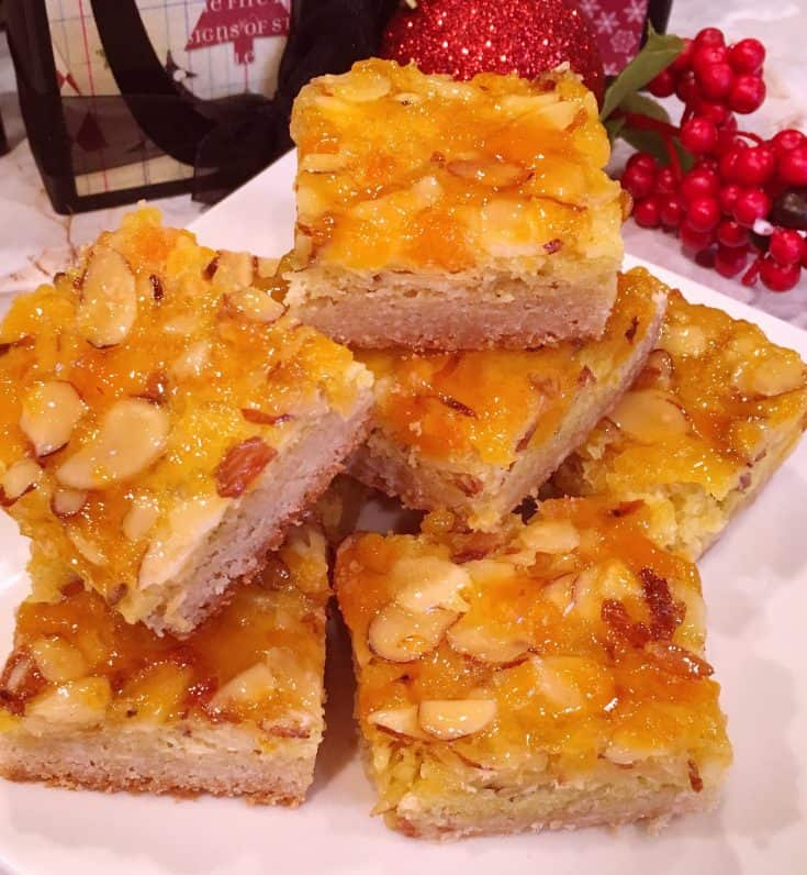 Tender buttery french vanilla crumb crust topped with chopped apricots and sliced almonds glazed with apricot jam. A scrumptious Holiday cookie!