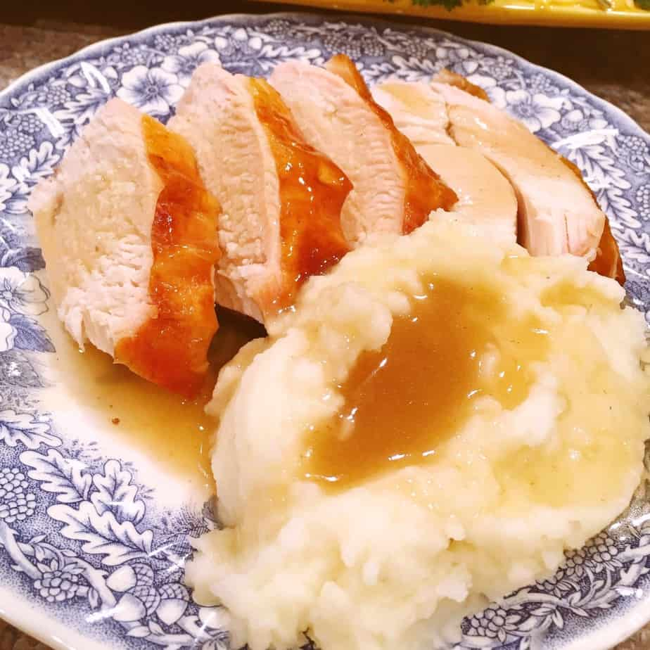 Turkey gravy over mashed potatoes and turkey