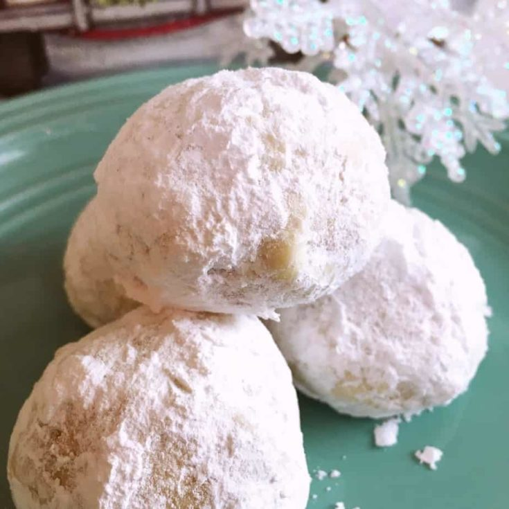 Buttery Shortbread cookies loaded with chopped pecans and rolled in powder sugar.