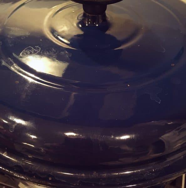 Lid covering pot while dumplings cook