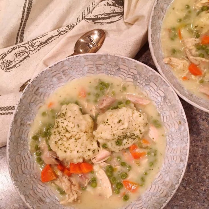 Rich Creamy Chicken and Vegetable soup with big fluffy old fashioined homemade herb dumplings.