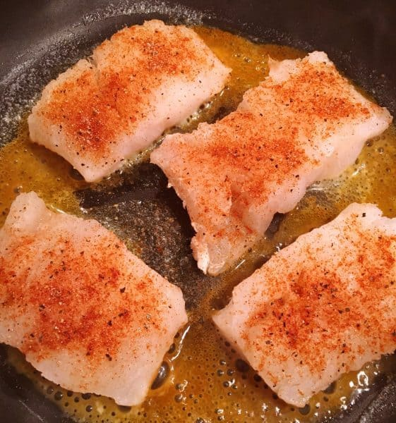 Seasoned Cod in hot buttered skillet