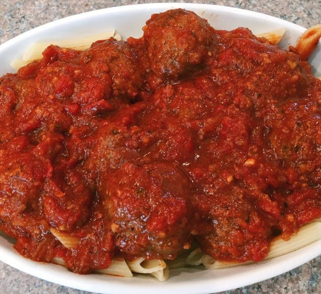 Tender flavorful slow cooked meatballs in a rich thick sauce. Perfect for pasta or Meatball Subs