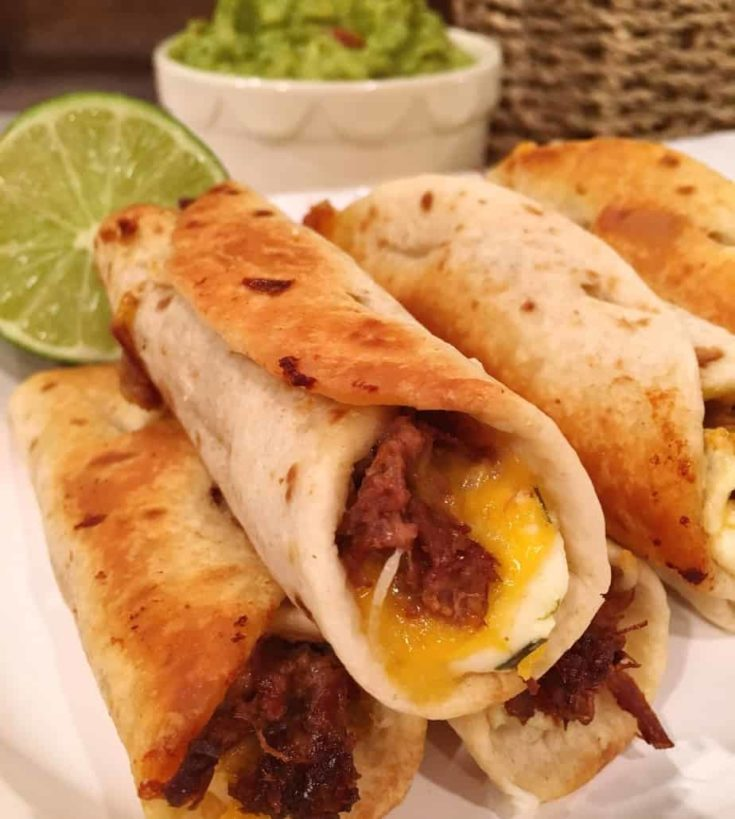 Mini Flour Tortillas stuffed with cream cheese, cheese, and seasoned beef, baked till golden and crispy.