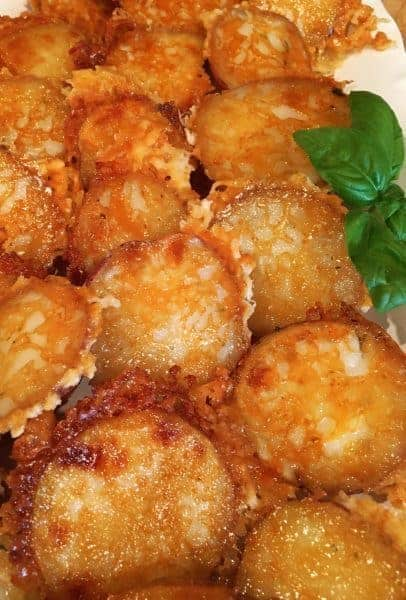 Tender Baby Red Potatoes baked in garlic butter and Parmesan Cheese to create a golden crispy delicious coating