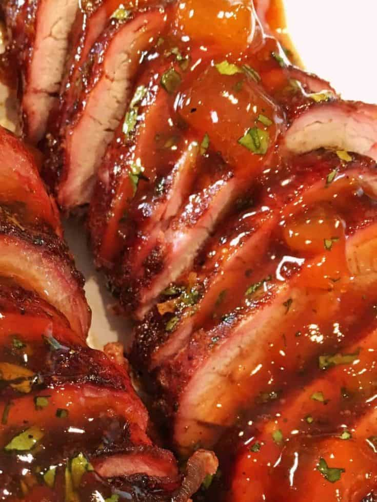 Tender moist pork tenderloin marinated in a Chili Rub and grilled to perfection. Topped with a Cilantro Apricot Glaze
