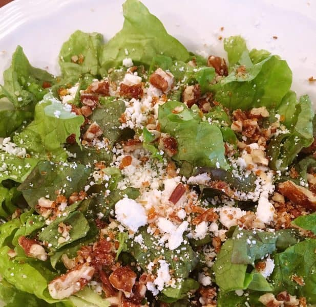 Lettuce topped with cheese and nuts