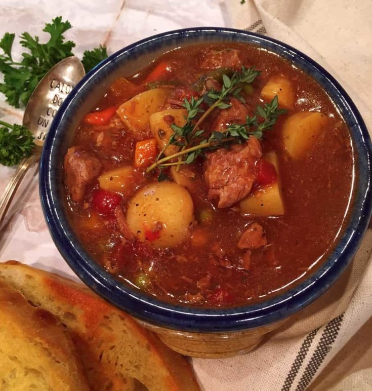 Thick Hearty Easy Slow Cooker Beef Stew full of tender chunks of beef, vegetables and a savory broth