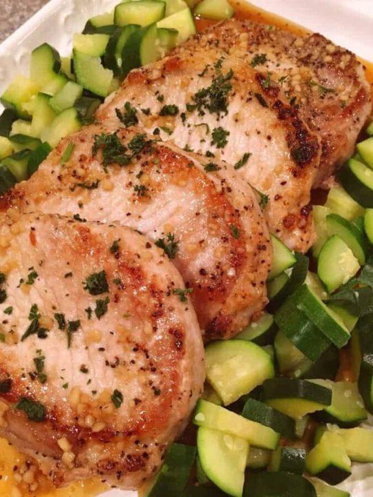 Serving platter fun of skillet honey garlic pork chops