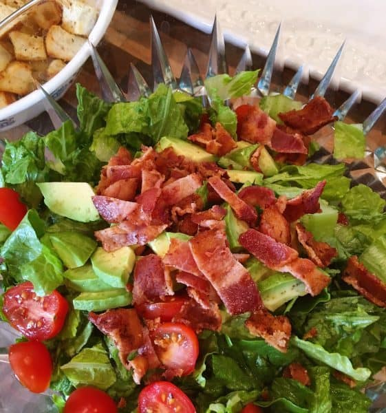 Lettuce, tomato, and bacon in salad bowl