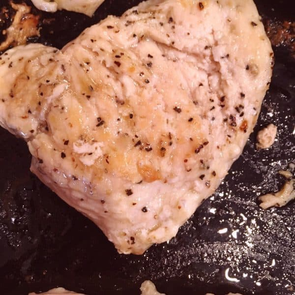 Chicken Breast cooking in skillet