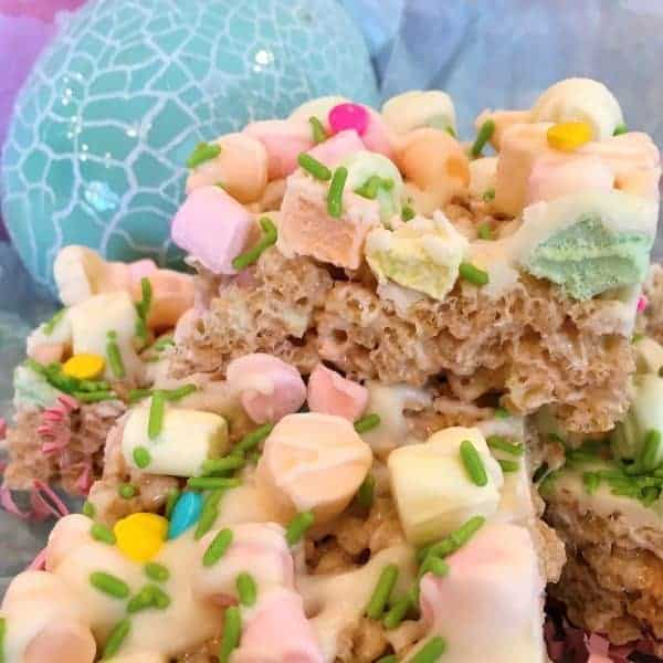 A fun colorful No-bake Easter Rice Krispie Treat that is ooey-gooey, rich, and chewy with white chocolate drizzle, pastel fruit marshmallows, and spring sprinkles.