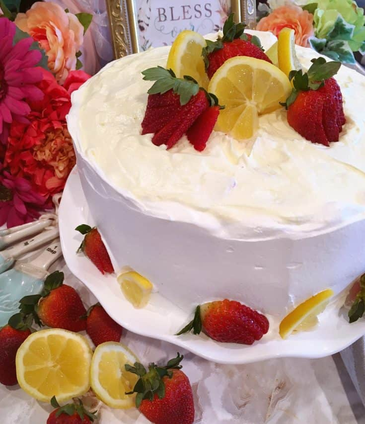 Moist French Vanilla Cake is layered with light flavorful fluffy Mock Lemon Chiffon filling and frosted with whipped cream. The perfect Spring Dessert.