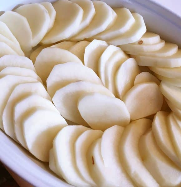 Sliced Potatoes in baking dish
