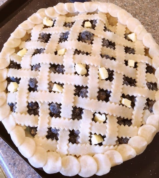 Fresh lattice work pie going in the oven
