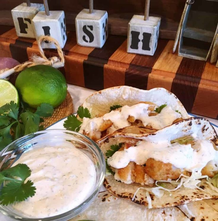Roasted corn tortillas filled with delicious Wild Alaskan Pollock fish sticks, finely shredded cabbage, and the most AMAZING taco sauce on the planet! Capers, cilantro, dill, cumin, lime,and chipotle peppers come together to make this amazing taco sauce.
