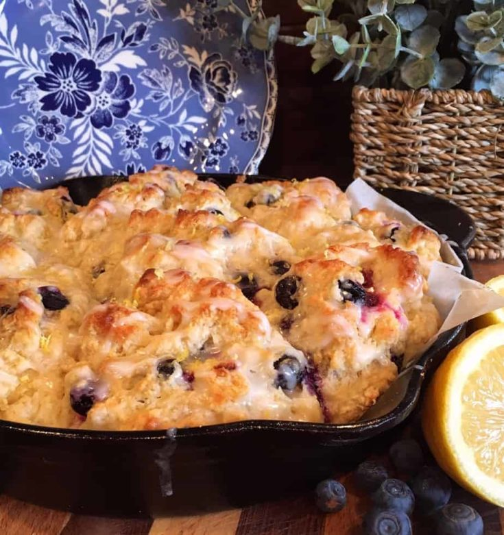 Blueberry Lemon Soda Bread Muffins are an enthusiastic nod to traditional Irish Soda Bread. They're a subtly sweet, moist, and light breakfast muffin with a tender crumb. Loaded with blueberries and lemon zest, topped with a fresh lemon glaze.