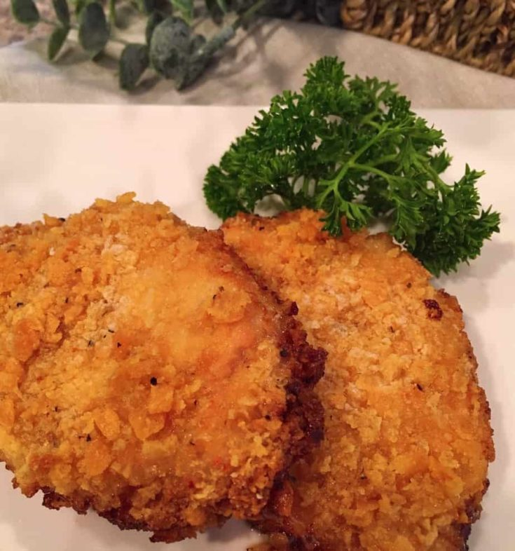 Boneless pork chops are coated in a buttery cracker coating and then oven fried in butter to create the most flavorful crispy budget family friendly main dish. One everyone at your Nest will love!