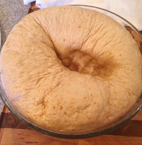 Carrot Cake Mix Cinnamon Roll raised dough punched down.