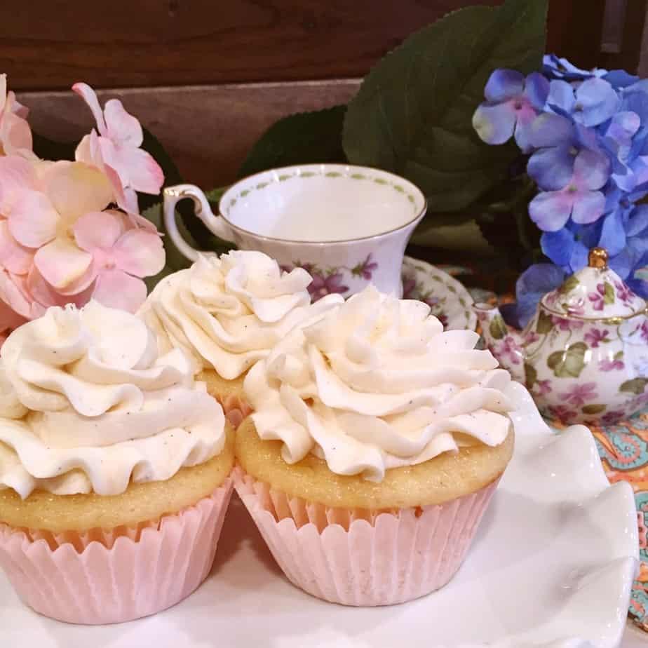 Vanilla cupcakes on cake plate