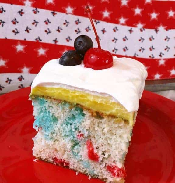 This creamy dreamy poke cake is heavenly and perfect for your 4th of July celebrations or any summer night. Serve it ice cold! It's AMAZING!