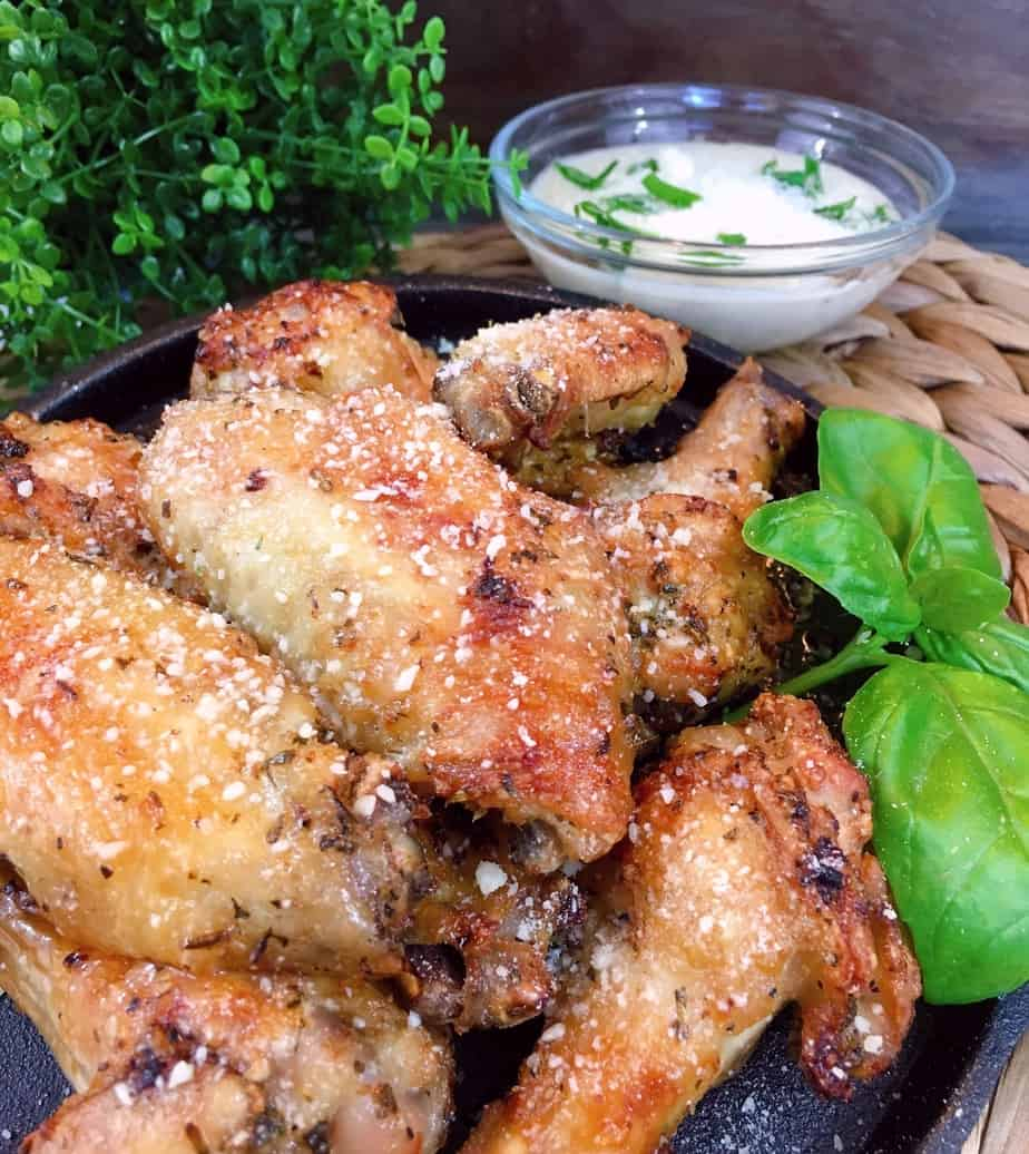 Air Fryer Parmesan Wings on a iron skillet with dipping sauce