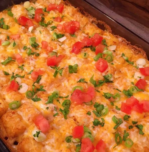 Casserole topped with chopped cilantro, green onions, and tomatoes