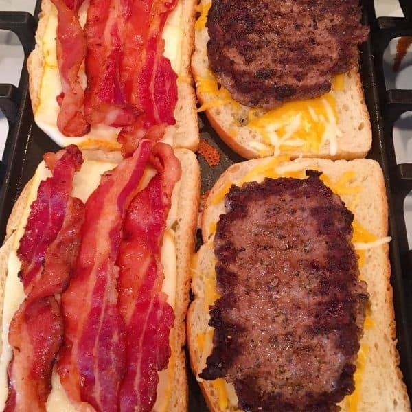 Bread and cheese on grill added hamburger patties and bacon.