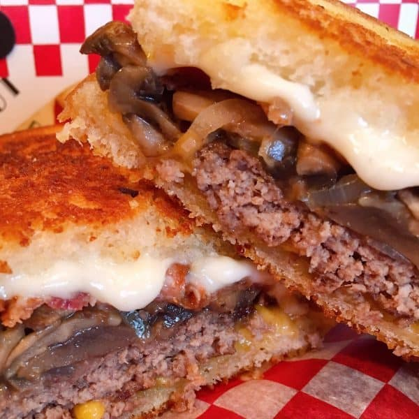 Ultimate Patty Melt put together and cut in half.