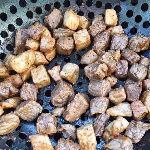 Grilled Pork and Steak in grilling basket