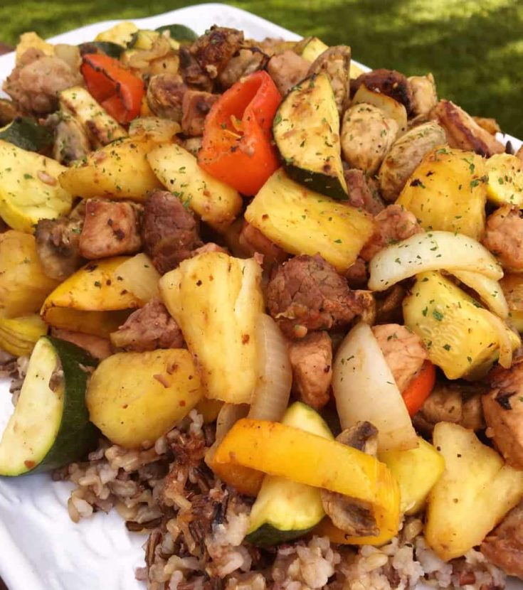 Marinated Steak and Pork, fresh squash, mushrooms, onions, peppers, and pineapple grilled to perfection and served on a bed of slow cooked wild rice.