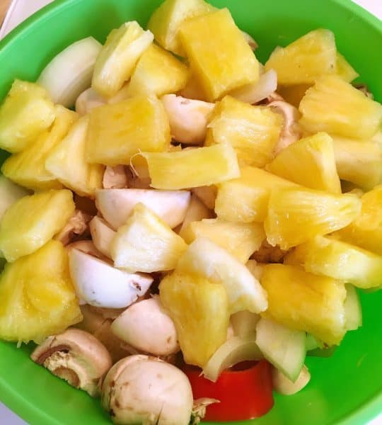 Mushrooms and pineapples cut up in bowl