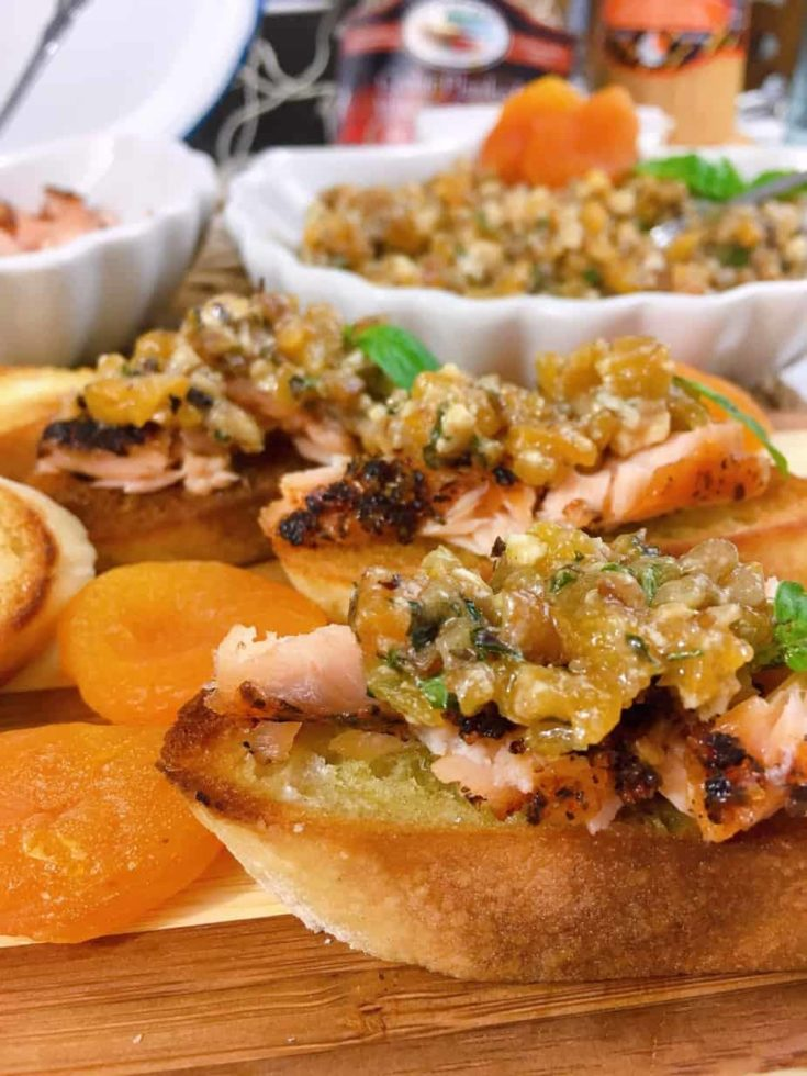 Crispy toasted baguettes topped with chunks of grilled salmon and a heaping scoop of Apricot Bruschetta loaded with diced dried apricots, feta cheese, toasted pecans, chopped fresh basil and a balsamic dressing. A fantastic summer or fall appetizer!