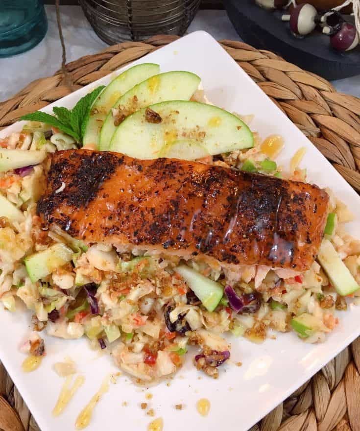 Fresh crisp delicious apple slaw pairs with grilled salmon to create a beautiful easy delicious entree that will impress your guests.
