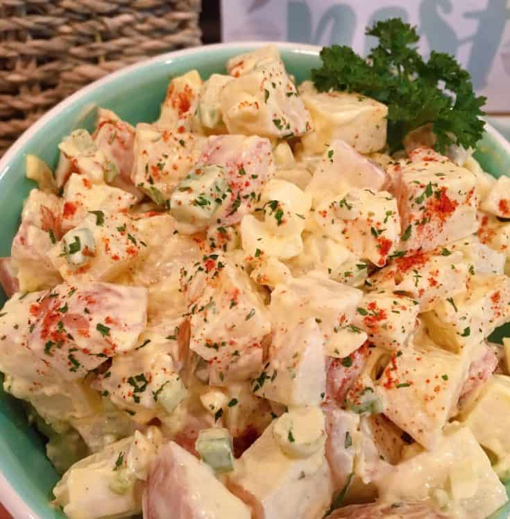 Creamy classic potato salad with tender red potatoes,  hard boiled eggs, celery, onion, dill pickles, seasonings, and mustard dressing. Just like Grandma used to make..maybe even better!