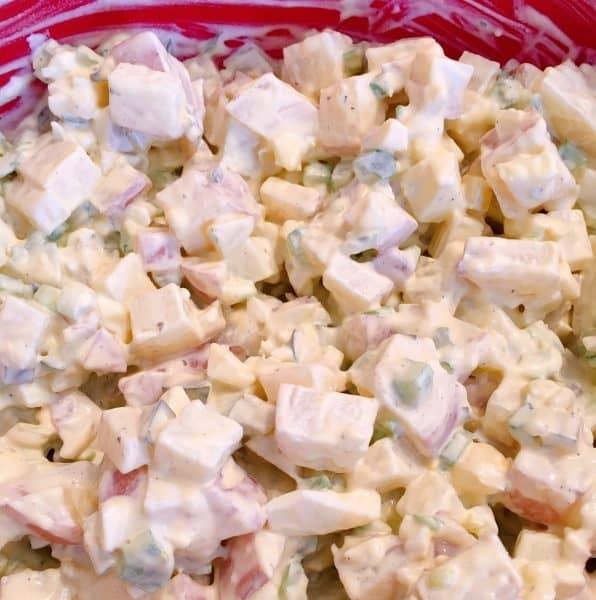 Mixed potato salad ingredients in large bowl