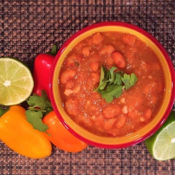 A traditional Tex Mex side item these tender Pinto Beans are slow cooked in a Rich Flavorful Sauce and are amazingly delicious!