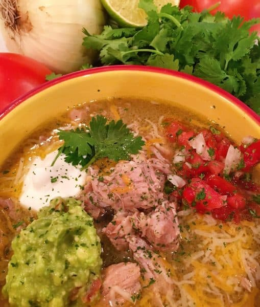Bowl full of Easy Instant Pot Chili Verde with toppings
