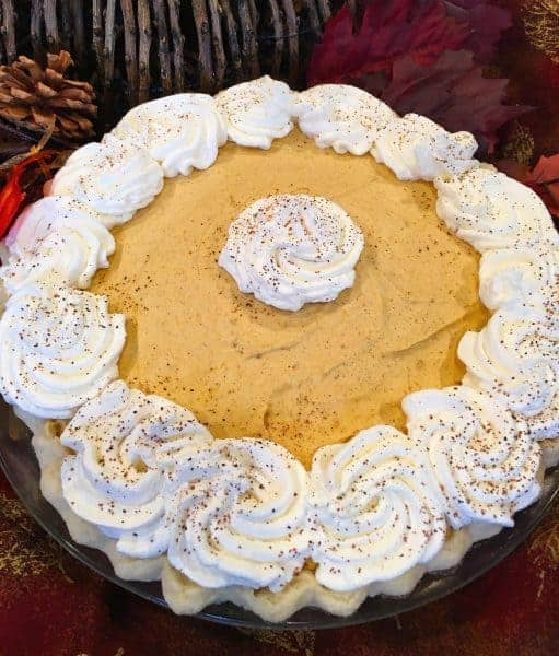 A light, fluffy, creamy, deliciously amazing Pumpkin Chiffon Pie! Like Pumpkin Mousse in a crust! Perfect for family get together's and Holiday meals. Sure to become a Family Favorite!