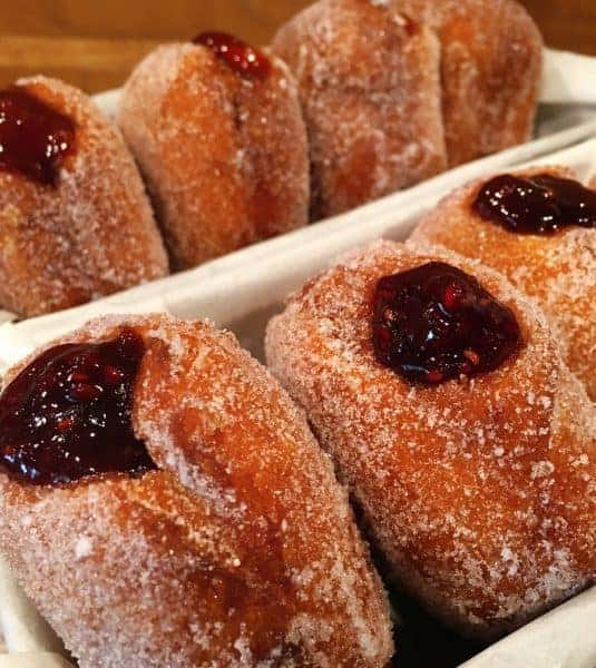 Jam filled donuts coated in sugar. An easy and delicious breakfast treat...or midnight snack!