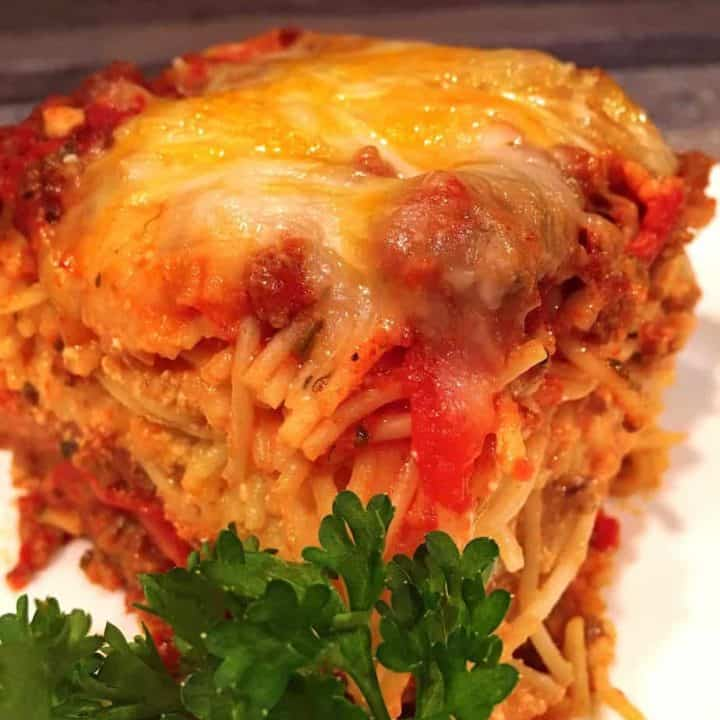 Meat Lover Baked Spaghetti cut and on a plate ready to eat.