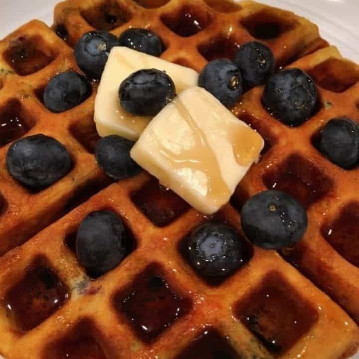 Blueberry Banana Belgian Waffles with butter and syrup