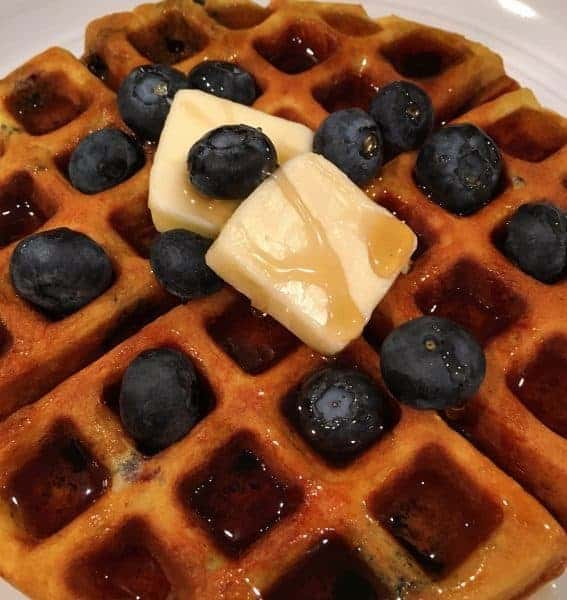 Light fluffy Belgian waffles with a hint of banana and fresh warm juicy blueberries. A spectacular and easy breakfast!
